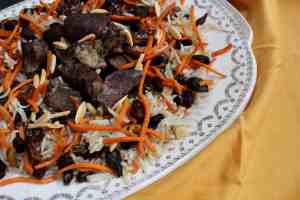 Kabuli Pulao (Spiced Lamb Pilaf) on yellow background