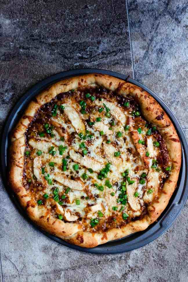 Full honey barbecue chicken pizza with green onions