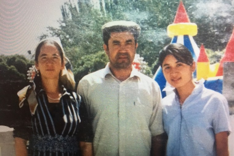 Nur Iman with her mother and father during a summer vacation to Kashgar, Xinjiang, in 2002.