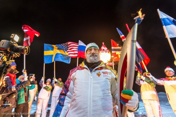 Chilingarov carrying the Olympic Torch. (c) Sergey Dolya