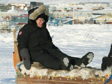 Governor of the Bank of England Mervyn King riding a dogsled in Iqaluit. © AP