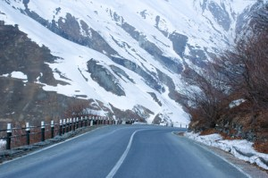 Empty road and mountains covered with snow