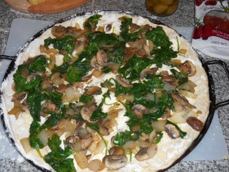 Onions, mushrooms, and spinach added on top of the cream cheese
