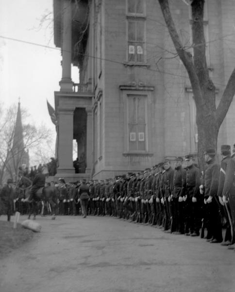 A military honor guard stands outside of the Wisconsin State Capitol during the funeral of Lucius Fairchild in 1896.