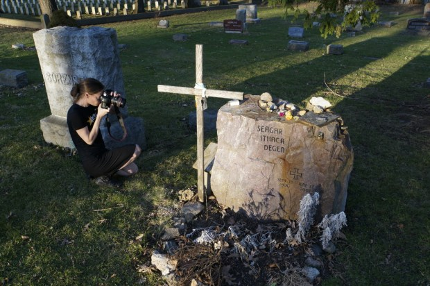 Helen J. Bullard Photographing Grave. Photo by William Cronon.