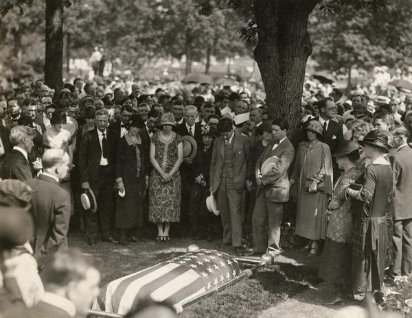 A large crowd of mourners gather around the casket of Robert La Follette during his funeral in 1925.