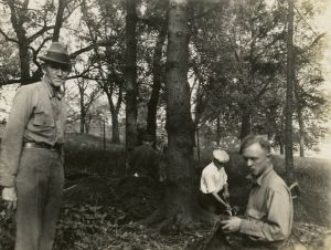Charles E. Brown (left), directs the excavation of a goose effigy mound at the Willow Drive mound group on the University of Wisconsin-Madison campus. Wisconsin Historical Society image 38995