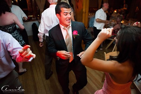 wedding guests partying at forest house lodge bar