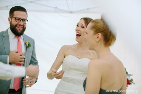 bride laughing with friends at the wedding
