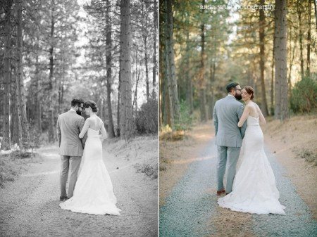 bride and groom casually walking in the forest