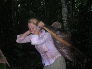 Amy Duchelle carrying Brazil nuts