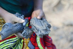 Women producing charcoal in Zambia