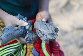 Women producing charcoal in Zambia