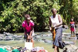 women, kenya women, wash clothes in river, river and water management, river, water towers, forest management, community participation research,