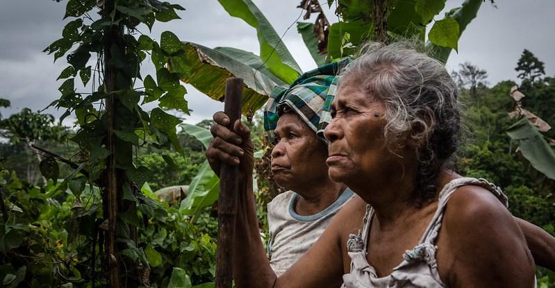 Women stand in their garden