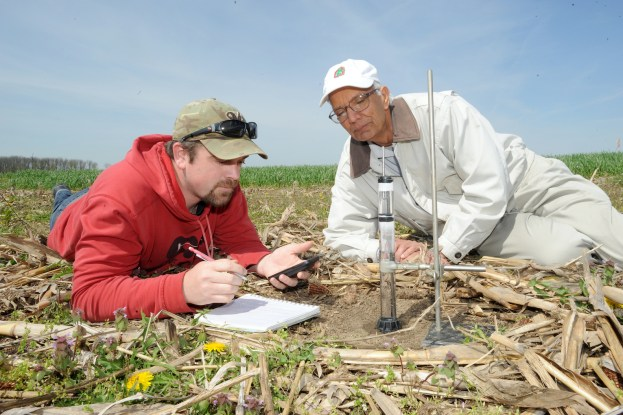 Men conducting soil research