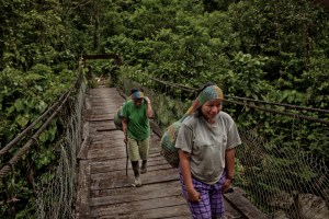 Community forestry in Ecuador: Leaving their oars behind the Kichwa villagers cross a bridge over the Jondachi river with their bounty. Photo: Tomas Munita/CIFOR