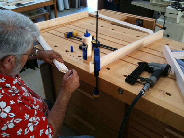 You need to use clamps to hold the pieces while you nail them together.
