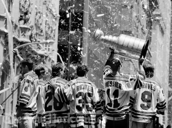 Hockey Playoffs: 1994. NHL. Canucks vs Rangers. Team raising Stanley Cup along ticker-tape parade route. (Nancy Siesel/The New York Times)