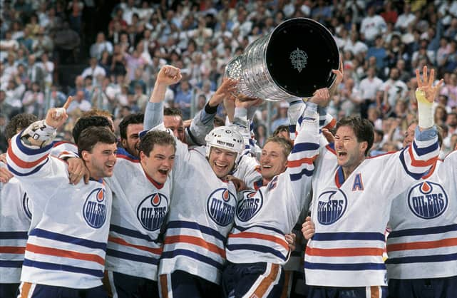 Gretzky and Messier raise the Cup for the 4th time (David E. Klutho/SI)