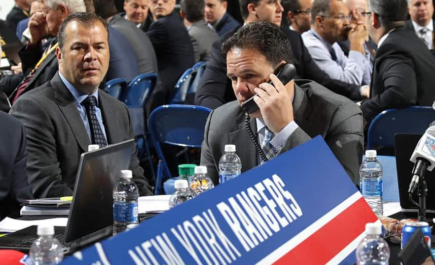 Gorton works the phone at the 2016 draft (NYR)