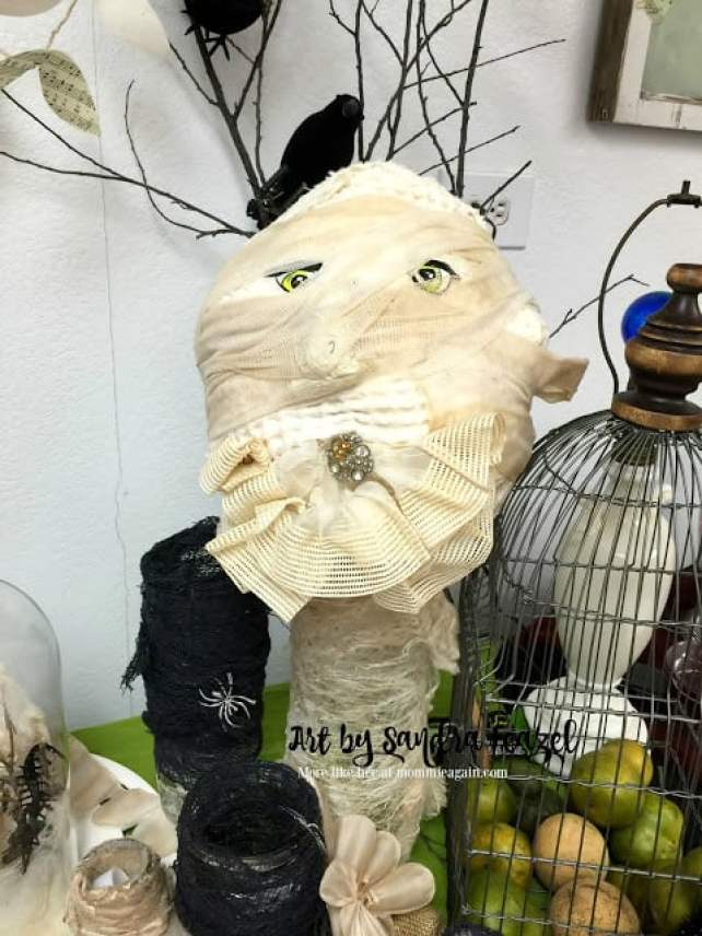 Handmade mummy from tie-dyed ribbons and lace