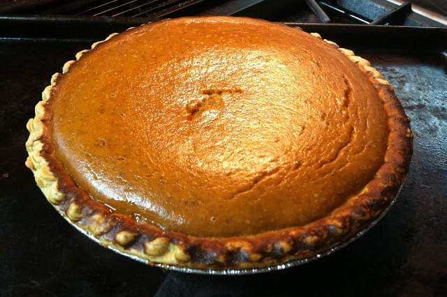 Homemade Pumpkin Pie on top of stove came right out of the oven with pretty hues