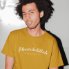 simple mockup of a man wearing a t shirt posing in flash photography 18081