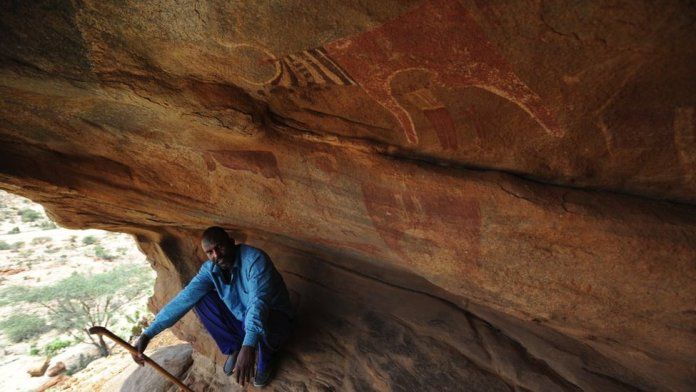 Rock paintings depicting hunters, long-horned cattle and antelope, giraffes and elephants decorate granite caves in Laas Geel, Somalia. Pictured in June 2017