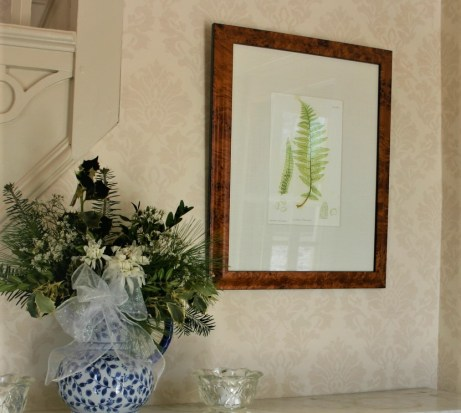 Fern Image in a Frame with base of dried flowers next to it
