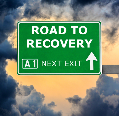 Road sign saying Road to Recovery AI Next Exit