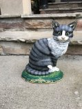 https://www.etsy.com/listing/474130704/vintage-cast-iron-cat-door-stop-metal?