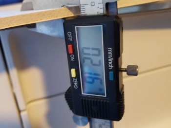 Using calipers to measure materials