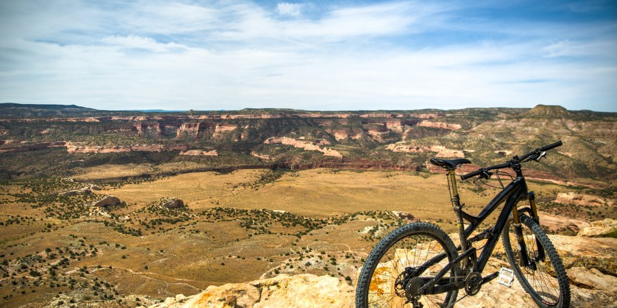 Mountain bike perched at the edge of a canyon