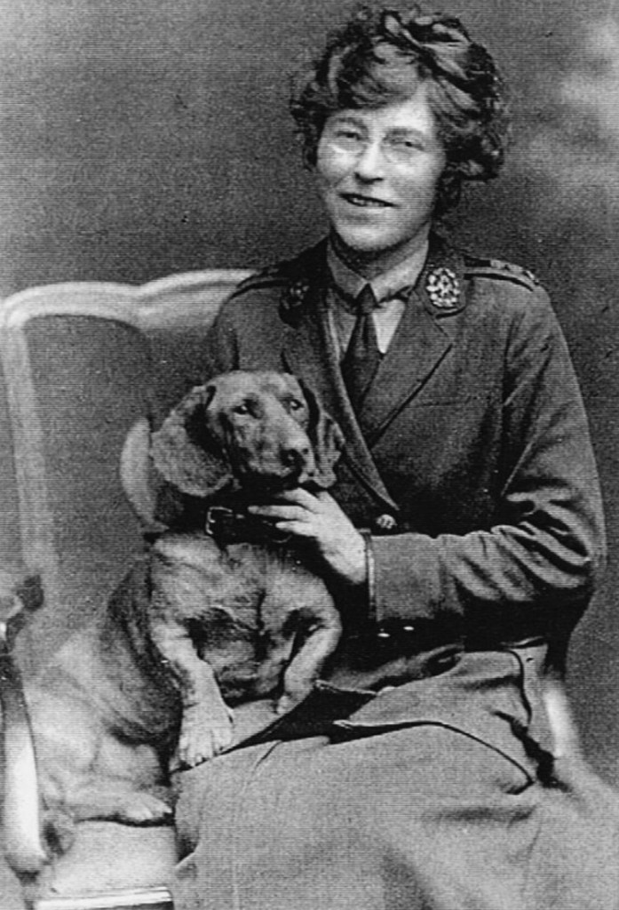 Florence Beaumont in war uniform with her dog.