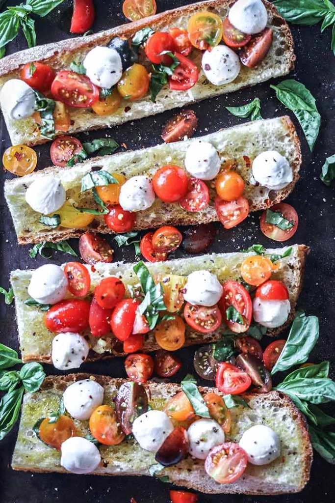 Caprese Ciabatta Toast, an open-faced ciabatta garlic bread topped with a caprese salad.