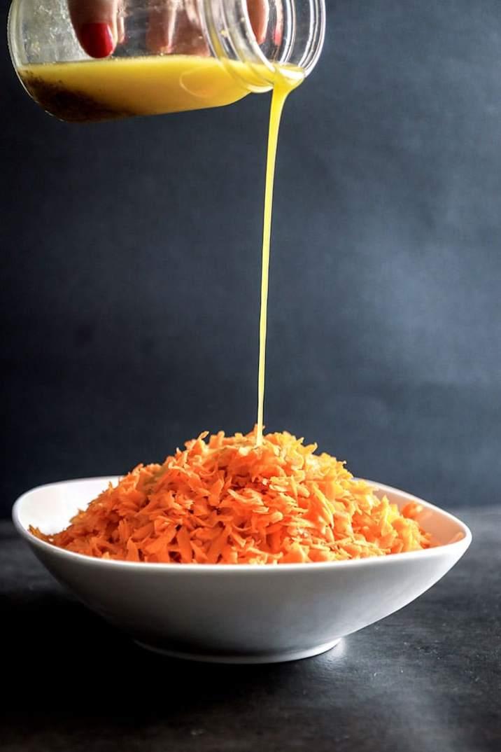 Honey Citrus Carrot Salad, a fresh, seasonal side dish or salad topper made fresh shredded carrots and a homemade honey citrus thyme dressing.