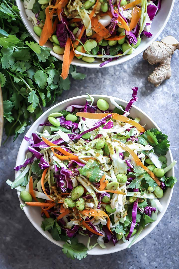 Miso Ginger Edamame Slaw, a light and fresh take on traditional coleslaw featuring green and red cabbage, edamame and a miso ginger dressing.