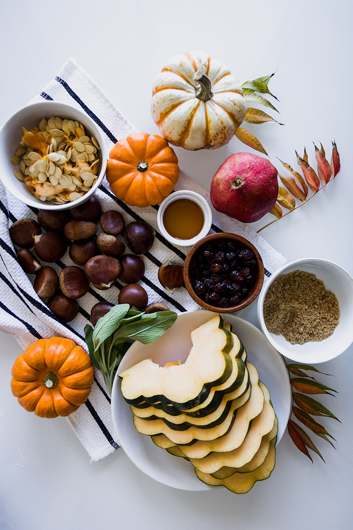 Fall Harvest Snack Board, a pickable platter of roasted pumpkin, acorn squash and autumn chestnuts with dried apple chips, pomegranate and cranberries.