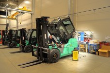 Man maintaining forklift