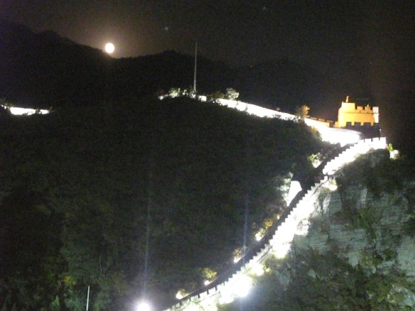 A full moon rises over The Great Wall.