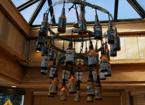 A chandelier made of old beer bottles at Half Moon Bay Brewing Co.