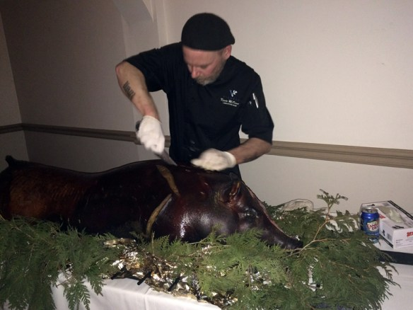 Chef Kevin carves one of Viamede's own heritage hogs.