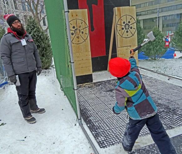 Joyeux Carnaval child throwing an axe
