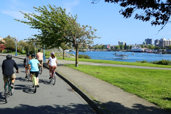 cyclists beside the water Bikes and Brews in Victoria, BC