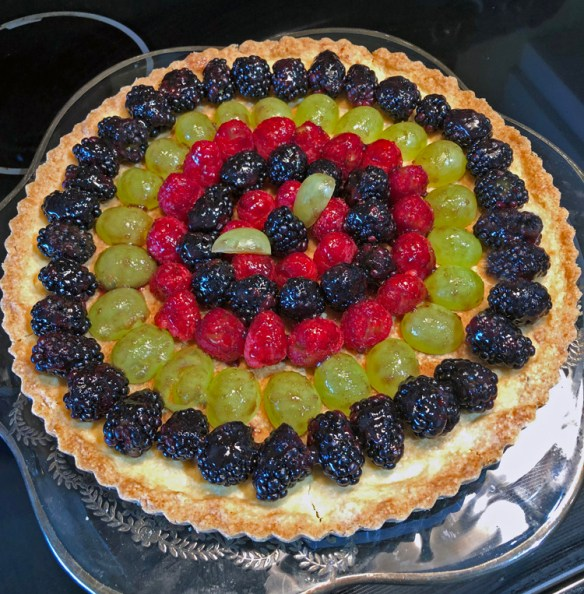fresh fruit arranged in a tart - Use your food processor to make this in a matter of minutes.
