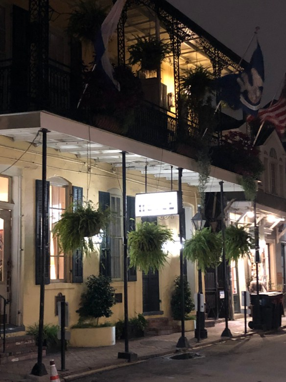 The Andrew Jackson Hotel exterior with ferns hanging from the canopy,