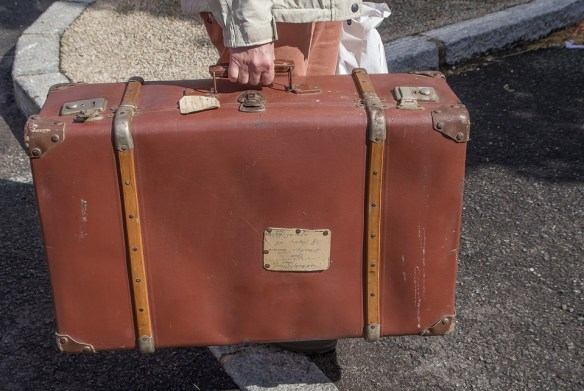 old fashioned suitcase in someone's hand