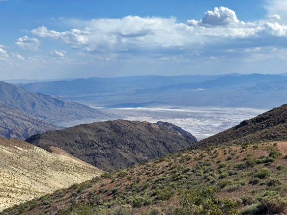 mountains and valley with what looks like water but is actually salt flats