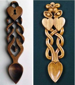 two Welsh carved wooden spoons, one with hearts and one with a lock